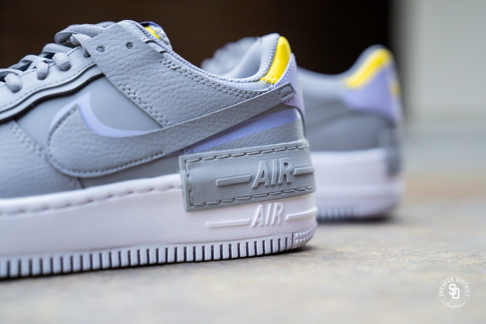 Nike Women S Air Force 1 Shadow Wolf Grey Lavender Mist Ci0919 002 This nike air force 1 comes constructed in a mix of leather and mesh with translucent overlays atop a solid grey rubber outsole. nike women s air force 1 shadow wolf grey lavender mist