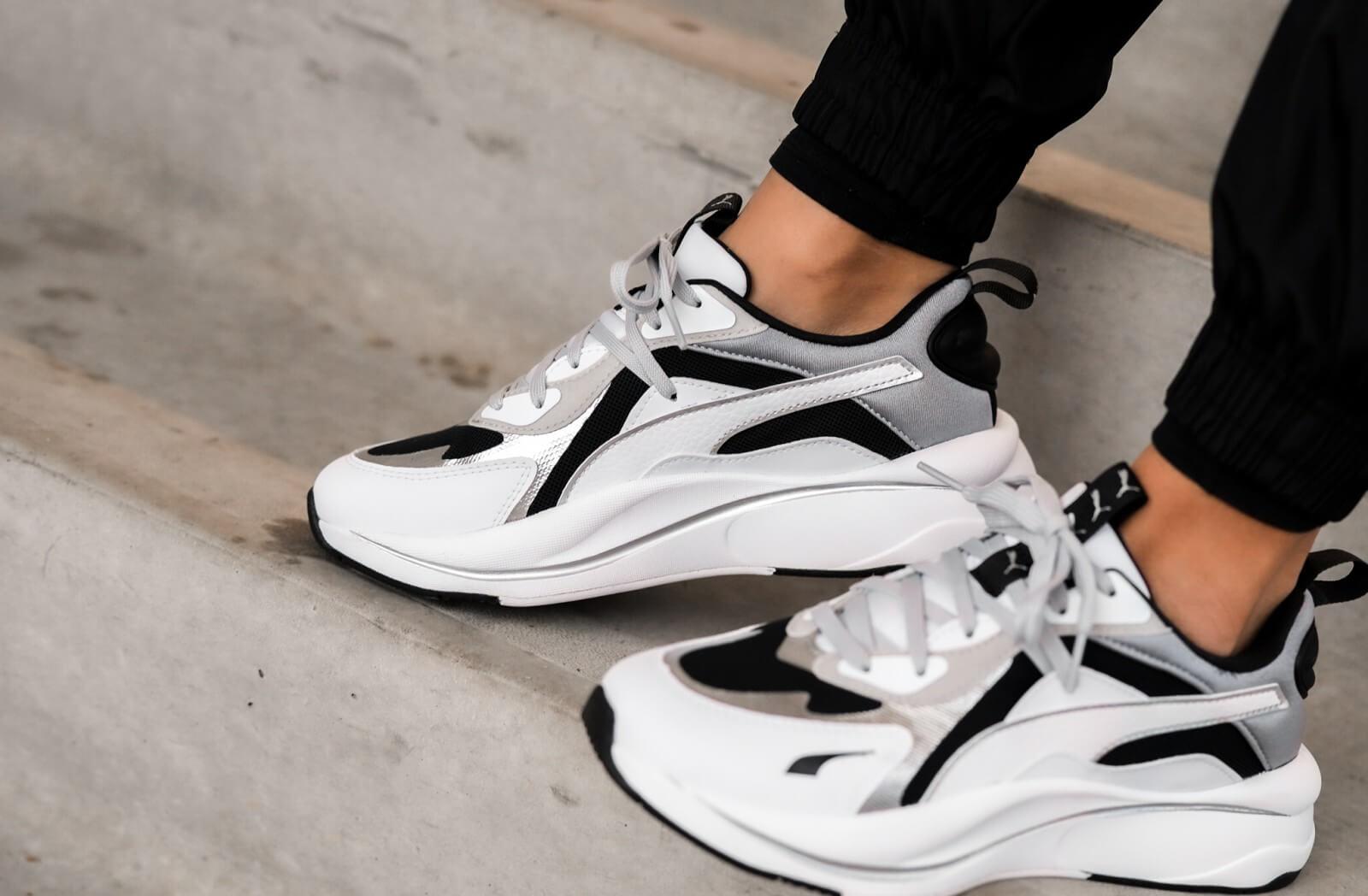 A picture of Women's RS-Curve Glow Puma Black/Puma White